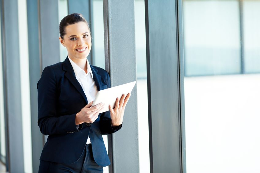 14898995 - attractive young businesswoman using tablet computer